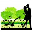 Stock Vector: Sillhouette of sweet young couple in love standing in the park