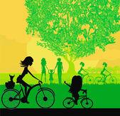 母亲和女儿在公园里骑自行车 — 图库矢量图片