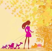 Meisje met haar hond in herfst landschap wandelen. — Stockvector