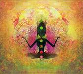 莲花瑜伽的姿势。padmasana 与彩色脉轮点. — 图库照片