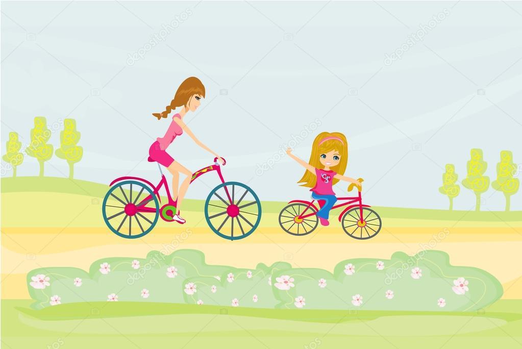 母亲和女儿骑山地自行车
