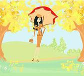 Beautiful woman with umbrella — Stock Vector