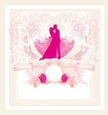 Blommig gratulationskort med silhuetten av romantiska par — Stockvektor