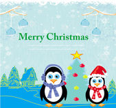 Christmas card with penguins — Stock Vector
