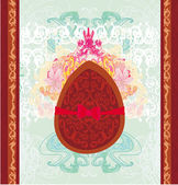 Vector illustration of chocolate egg with red bow — Stockvektor