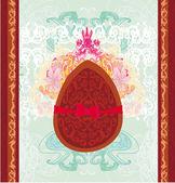 векторная иллюстрация шоколадное яйцо с красным бантом — Cтоковый вектор