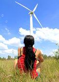 Girl near a wind turbine — Stock Photo