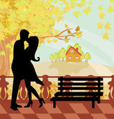 Kissing couple in autumn day — Vector de stock