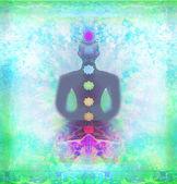 Yoga lotus pose. Padmasana with colored chakra points.  — Stock fotografie