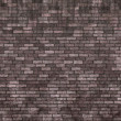 Aged brick wall — Stockfoto