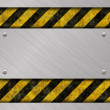 Stock Photo: Brushed metal banner and warning sign