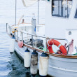Fishing boat in summer outside in sea at harbour - Stock Photo
