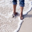 Barefoot in the sand in summer holidays relaxing — Stock Photo