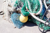 Fishnet trawl rope putdoor in summer at harbour — Stock Photo