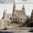 Creative big sandcastle on the beauch in summer — Stock Photo