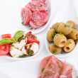 Deliscious antipasti plate with parma parmesan and olives — Stock Photo