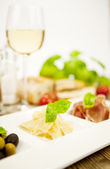 Deliscious antipasti plate with parma parmesan olives — Stock Photo
