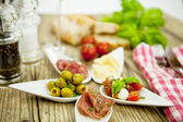 Deliscious antipasti plate with parma parmesan olives — Foto Stock