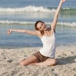 Woman with bikini in the sea jumping portrait — Stock Photo #13557055