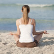 Woman doing yoga on the beach Sports Landscape — Stock Photo #13557096