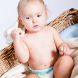 Cute little baby infant in basket with teddy - Photo