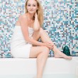 Blonde woman with towel in a whirlpool spa - Stock Photo