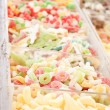 Delicious assortement of sweets on market - Stock Photo