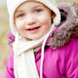 Cute little girl with hat and scarf in autumn winter — Stock Photo