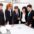 Business team looking architecture project — Stock Photo #15632909
