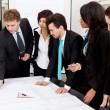 Stock Photo: Business team looking architecture project