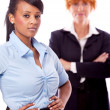 Royalty-Free Stock Photo: Young african business woman with redhead adult woman