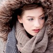 Young woman with jacket coat and hood in winter — Stock Photo #15633529