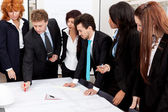 Business team looking architecture project — Stock Photo