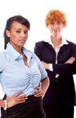 Young african business woman with redhead adult woman — Stock Photo