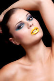 Woman with extreme colorfull make up in blue and yellow — Stock Photo