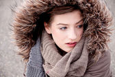 Young woman with jacket coat and hood in winter — Foto de Stock