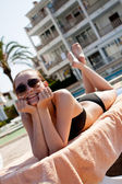 Sexy woman in bikini relax on sunlounger sunbathing — Stock Photo