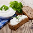Yoghurt creamy cheese with herbs and bread - Stock Photo