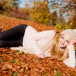 Young woman outdoor in autumn warm clothes — Stock Photo