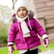 Stock Photo: Cute little child in pink jacket and hat outdoor