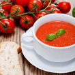 Tasty fresh tomato soup basil and bread — Stock Photo #16976523