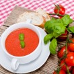 Tasty fresh tomato soup basil and bread — Stock Photo #16976555