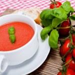 Tasty fresh tomato soup basil and bread — Stock Photo #16976583