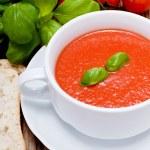 Tasty fresh tomato soup basil and bread — Stock Photo #16976689