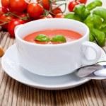 Tasty fresh tomato soup basil and bread — Stock Photo #16976741