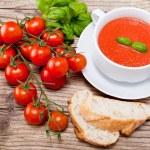 Tasty fresh tomato soup basil and bread — Stock Photo #16976771
