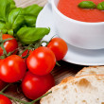 Tasty fresh tomato soup basil and bread — Stock Photo #16976799