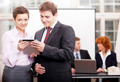 Business team with tablet cellphone computer — Stock Photo
