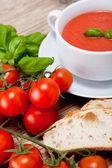 Tasty fresh tomato soup basil and bread — Stock Photo