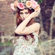 Beautfiul woman outdoor in summer with flowers on head — Stock Photo